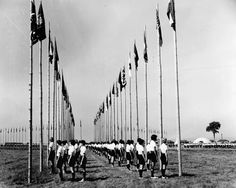 1962 Int'l Girl Scout Senior Roundup. 200 flags were raised each day at Button Bay, VT, by 329 girls from all parts of the world.