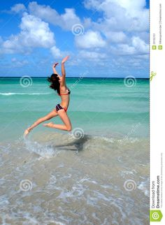 38b8c813bca8 Nice Young Girl Is Jumping Close To Ocean Stock Image - Image of beautiful