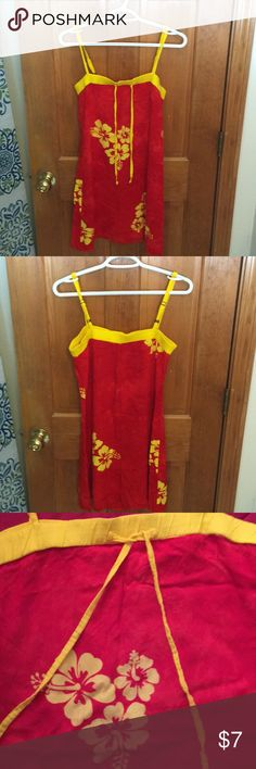Handmade Sundress from Costa Rica Adorable sundress from Costa Rica. Red with yellow trim, chest drawstring, and floral design.  There is no interior tagso price has been adjusted accordingly.  Gently worn. Dresses