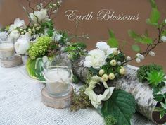 One of our birch log natural looking centerpieces. Great for long tables.