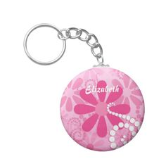 A cute and girly pink and white floral keychain for a teen girl with pink retro daisies and white circle swirls. This pretty flowers design can be personalized by adding the name of any girlie girl.