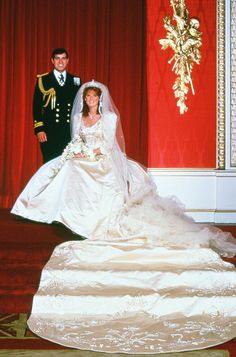 Prince Andrew to Sarah Ferguson on July 23rd, 1986.  This was also another televised Royal Wedding with an audience of 500 million tuned in, not as many as the previous one but still an astonishing amount of  viewers!  Her gown was made in a creamy ivory Duchess Satin.  A scooped neckline edged with pearls, a bodice with boning and a dropped waist that came to a v-point in the front and back.  The sleeves themselves were full at the shoulders and tapered to just below the elbow.