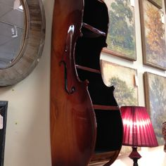 Cello turned shelf- gorgeous but idk if I could ever mutilate a cello like this!