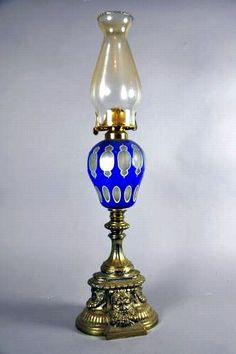 Victorian blue overlay glass fuel lamp with cast mask base - Lamps - Kerosene/Oil - Lighting Antique Oil Lamps, Vintage Lamps, Oil Light, Light Up, Kerosene Lamp, Oil Candles, Victorian Furniture, Lamp Light, Lanterns