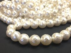 AA Grade 8 mm. White Mother of Pearl Faceted Round by colorstones