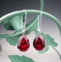 Hey, I found this really awesome Etsy listing at https://www.etsy.com/listing/178040856/ruby-red-rhinestone-earrings-wedding