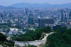 Part of the 18km, 12 metre high fortress wall that surrounds parts of the city of Seoul. ~S. Korea