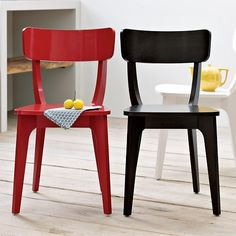 a more modern option for the dining room chairs - red of course!! -- to cheer up our dining room -- and hopefully at first they won't squeak when we sit on them.