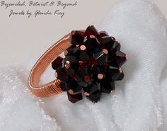 Gorgeous Garnet Swarovski Crystals are individually hinged and wrapped into one big cluster with Non-tarnish coated Copper wire and securly wrapped into the base of the ring band. This ring was crafted to last for many years to come and is a perfect sz-8. Free Shipping Within the USA