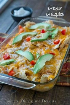 Chicken Chilaquiles -A Mexican casserole with tortilla chips, and chicken baked in a spicy tomato sauce, and topped cheese.