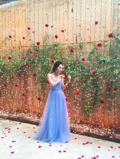 Red rose and fairy light backdrop and bride in icy blue wedding gown by Celest Thoi // The Wedding Scoop's styled shoot