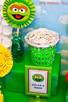 Oscar the Grouch's Trash with a Food Table Tent Card for a Sesame Street / Elmo Themed Birthday Party!  Come check out all of the DIY decorations and colorful, festive party flare (including free printabels) at Melly Moments Blog!  Save yourself the time, energy, and money while planning a fabulous party for your kids!