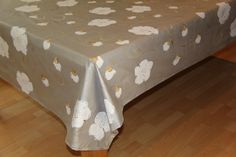 Hand Painted by Dana Easy to clean tablecloths, Silver white and gold. DMG Designs. www.dmgdesigns.co.za or fadje@mweb.co.za