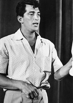 Dean Martin- attention to the open shirt. :-)