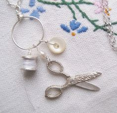 Sewing necklace with handmade fine silver cotton reel, 1930s moving silver scissors and vintage mother of pearl button