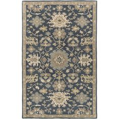 Complete any setting with this transitional area rug. Hund-tufted with 100-percent wool, this rug is sure to be the finishing touch you've been searching for.
