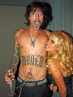Tommy Lee & Pam Anderson...IMHO the perfect match.....ADORE both of them. Both so smoking hot!