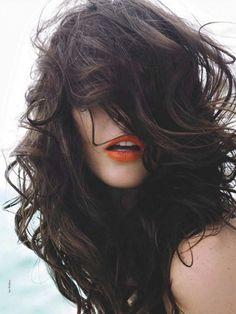 dark hair, coral lips.