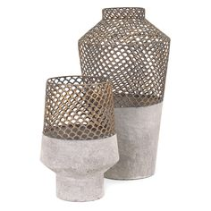 IMAX Rowan Metal Vase - Iron out your signature style with the IMAX Rowan Metal Vase . A lacy, latticed upper with a scalloped pattern meets the durable metal base with...