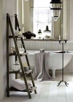 Clawfoot tub and rustic ladder.