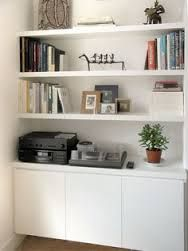 Simple contemporary white painted alcove unit and floating shelves