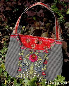 Gipsy Quilt - here's what to do with those bright floral remnants - peek-a-boo purse linings.