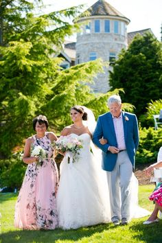 Bride walked down the aisle by her parents  Tacoma Wedding Photography