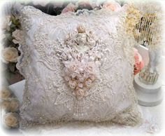 Our 17 x 17 Square Gilded Opulence Pillows are lined with an elegant jacquard in antique gold and soft ivory. They are trimmed to perfection with embroidered and hand beaded lace, custom dyed florals