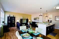 Open living space connects to premium kitchen.