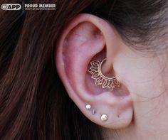 """Daith piercing with a yellow gold """"Azalea"""" from Body Vision Los Angelas. Piercing performed by Westin Michael during a guest spot at Saint Sabrina's."""