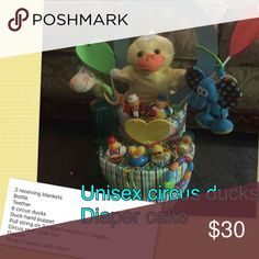 Unisex circus ducks diaper cake 2 receiving blankets  Bottle Teether 6 circus ducks Duck hand puppet Pull string on 3 legged elephant n wiggles Circus stuff rattle lion  Diapers  Wrap in plastic with ribbon Accessories