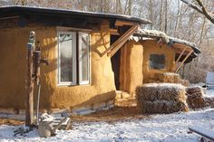 How to Build a Straw Bale House - They've also built a zero-energy refrigeration unit using a pipe that runs through the cool soil beneath the house | Modern Farmer