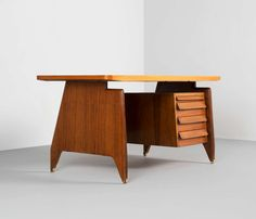 Italian Desk in Rosewood, 1950s | From a unique collection of antique and modern desks and writing tables at https://www.1stdibs.com/furniture/tables/desks-writing-tables/