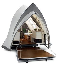 Tent Camper Opera House Design: The Opera is a mobile designer suite offering you the convenience of a complete holiday home. It has teak veranda, two electrically adjustable beds, ceramic toilet, top loading refrigerator, low-energy lighting, hot air heating and a boiler to supply warm water to the kitchen, the fountain and the (exterior) shower.