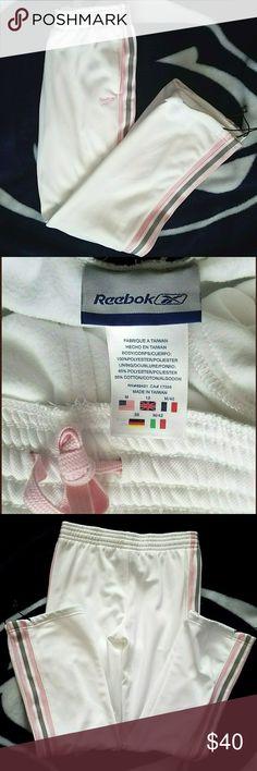 Reebok  white, pink, grey Pants/Sweatpants Reebok pants/sweats The inside lining is fleece. Bottom opening has drawstring   Approximate measurements: Waist- 30in. / 76.2cm. Rise- 10 in. / 25.4 cm. Length- 40.5 in / 102.9 cm. Inseam- 30 in / 76.2 cm. Reebok Pants Track Pants & Joggers