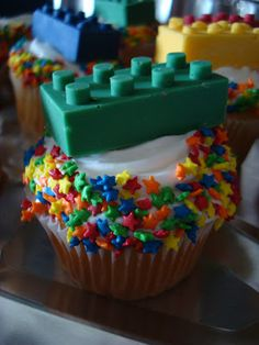 cute lego cupcakes using colored chocolate melts and a silicone Lego mold.