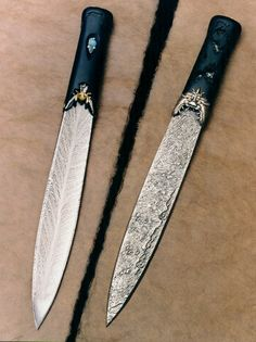 """Another WOW!  Life and Death Dagger: Feather pattern Damascus steel and textured wrought iron blade, 10"""" by Don Fogg. The handle features a carved silver and gold demon on the textured side with carved ebony. On the reverse, a silver and gold orchid flower with carved ebony and inlay stone. Handle work by Jim Kelso."""