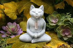 This serene Buddha Cat Statue is meditating in the lotus position and wearing a silver Namaste necklace. The word Namaste can be simply translated as: The divine in me recognizes the divine in you. The expression on the face of this this divine feline says it all. What a great addition to your zen garden!  ☀ Buddha Cat is approximately 3.75 Tall x 3.25 Wide x 1.5 Deep. Dont let these measurements fool you -- this is a nice size statue as you can see by the photo of it in my hand ☀ Cat Buddha…