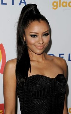 Kat Graham pairs her dark pony with a black evening gown and looks stunning in it