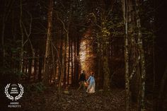 Award-winning pregnancy picture - Baby Photo Awards - mom and dad walking in the forest at sunset - Zephyr & Luna photograhy