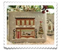 """""""Toy Store"""" is the title of this cross stitch pattern that is part of the Hometown Holiday line from Little House Needleworks."""