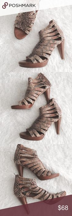Jeffrey Camp. Marly Snakeskin Suede Gladiator Heel Caged heeled platform sandal. Snakeskin embossed suede. Zipper fly closure on the back of the heel. About 4.5in heel & 1in platform. Super cute! Small scratches on the heels by overall in great condition.   •USE OFFER FEATURE TO NEGOTIATE  •BUNDLE TO SAVE  •NO OUTSIDE TRANSACTIONS •NO TRADES Jeffrey Campbell Shoes Heels