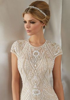 Chevron and floral beadwork adorns this fitted Mori Lee 6869 Musidora wedding dress, styled in tulle over lace, with cap sleeves framing the jewel neckline. Bridal Wedding Dresses, Wedding Dress Styles, Designer Wedding Dresses, Mori Lee Wedding Dress, Wedding Ceremony, Tall Wedding Gowns, Art Deco Wedding Dress, Wedding Hair, Vestido Charleston