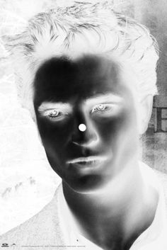 Look at the dot on Rob's nose for about 20 sec. Then look at the ceiling and blink a few times. You will see his real face. So weird!