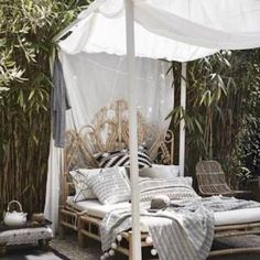 ☀️Hello Sunday! You can't do this with a timber bed people! Rattan gives you so many options to create stunning spaces, inside & out. I'll be spending my day here.  Shop our rattan beds & you can live the dream. Link in bio. Pinterest inspo.   #therattancollective #rattan #rattanisthenewblack #boho #bohemian #beach #relax #sundays #weekends #summer #lounge #interiordesign #garden #wanderlust #gypsy #gypsystyle #cocktails #byronbay #bondi #cairns #whitsundays