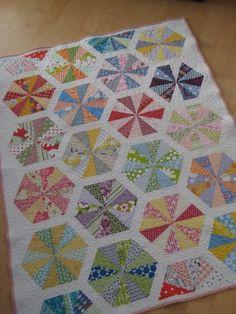 motleycraft-o-rama:  Tolva Quilt, by Flekka 5x3 rectangle, draw line diagonally across, sew 1/4 inch from line on both sides, cut line. 6 fabrics per hexagon (3 yellow, 3 blue, etc)
