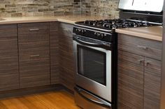 Liking the cabinets - wood and contemporary look Kitchen Cabinet Colors, Kitchen Colors, Contemporary Kitchen Cabinets, Atomic Ranch, Wood Cabinets, Kitchen Remodel, Porch, Kitchen Appliances, Colorful
