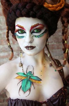 The scarab is painted on, but even so.  Make-up by Sophia Benomar