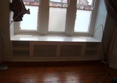 A window seat, which gives storage and ventilation for radiator