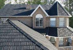 Portland Metal Roofing: Keith Green Construction Inc. offers beautifully designed metal roof installation & repair in Portland, Beaverton and Hillsboro. Metal Roof Installation, Rubber Roofing, Rubber Tiles, Residential Roofing, Roofing Companies, Recycled Rubber, Recycled Tires, Recycled Materials, Slate Roof